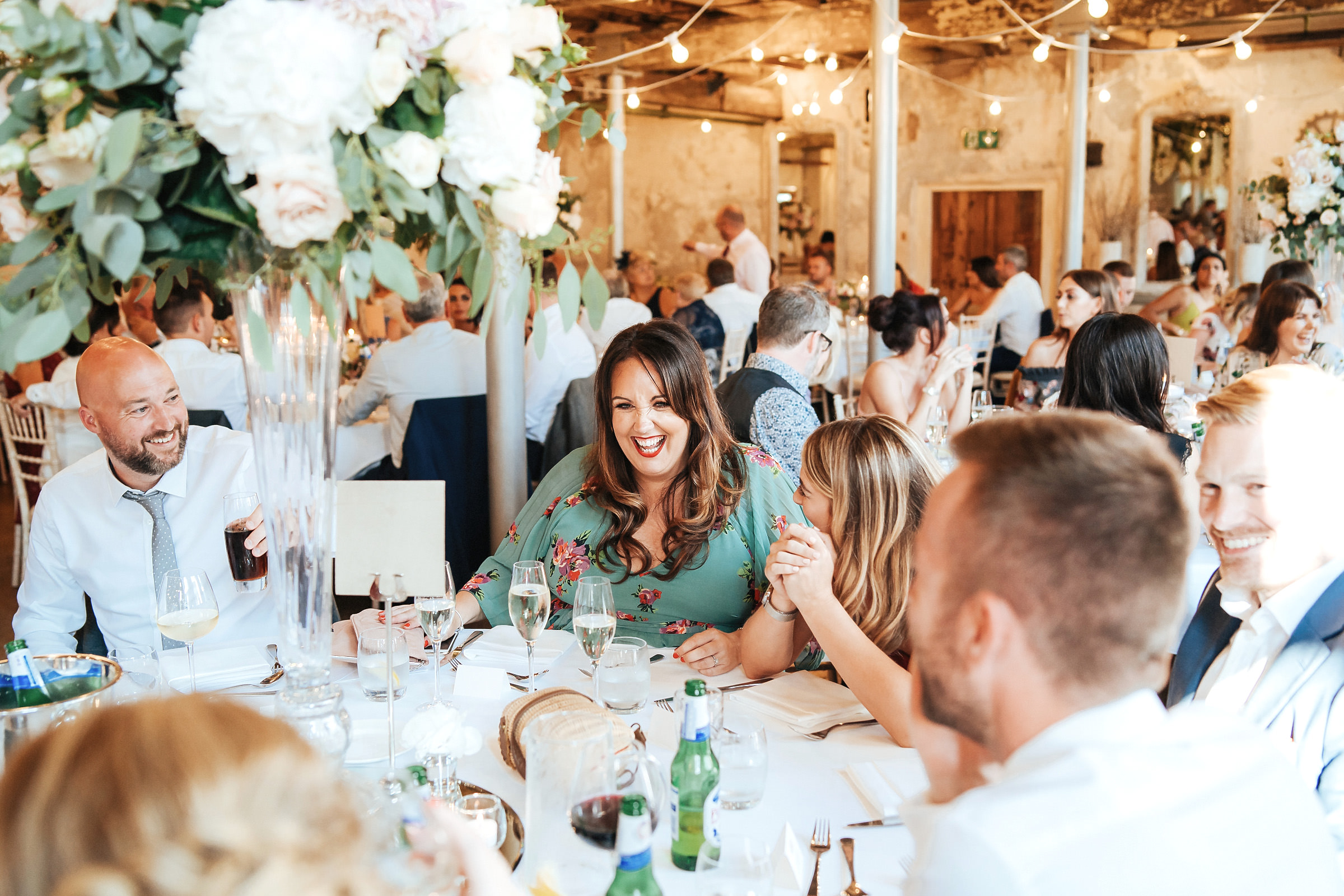 wedding guests seated at table