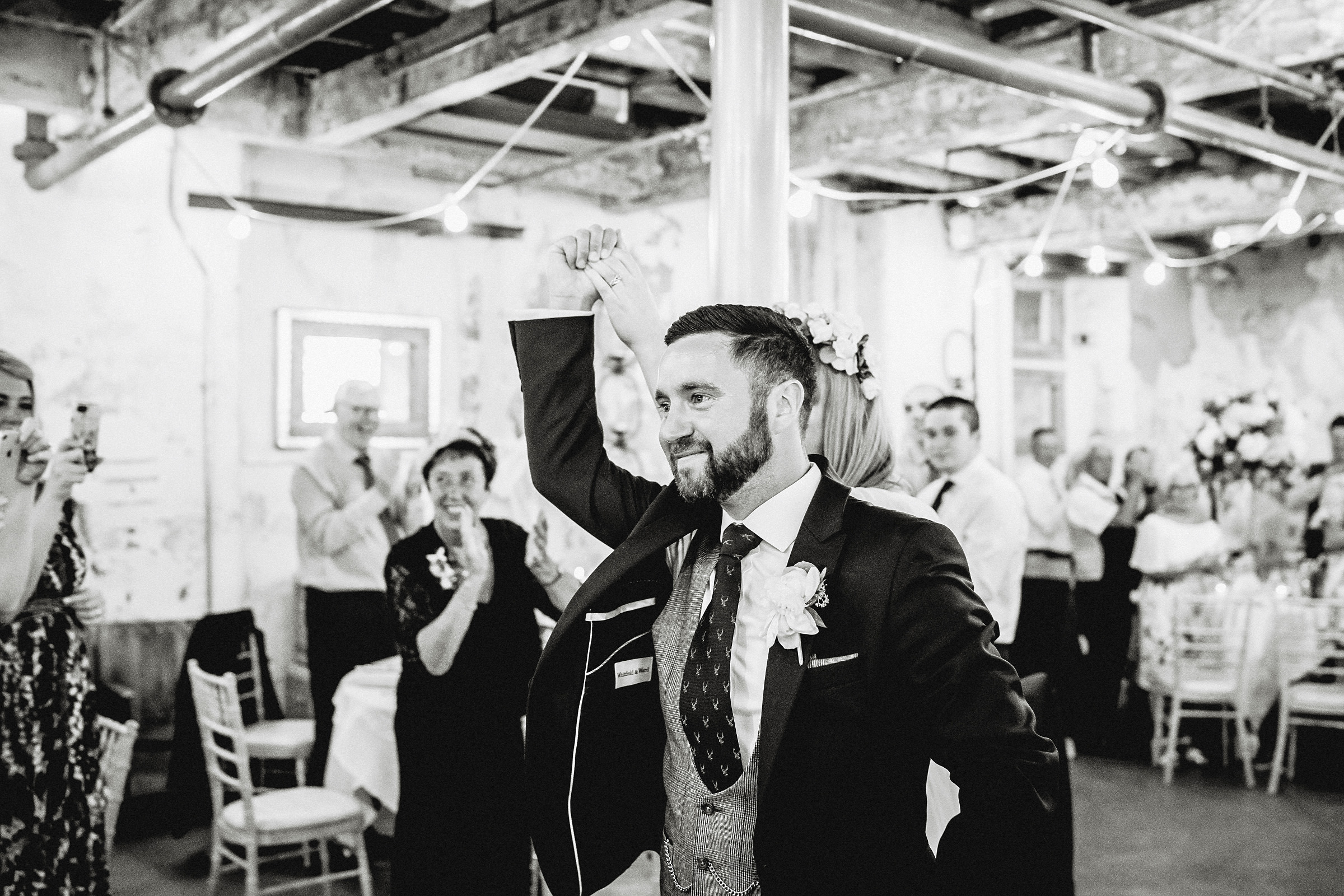 groom raising celebratory fist