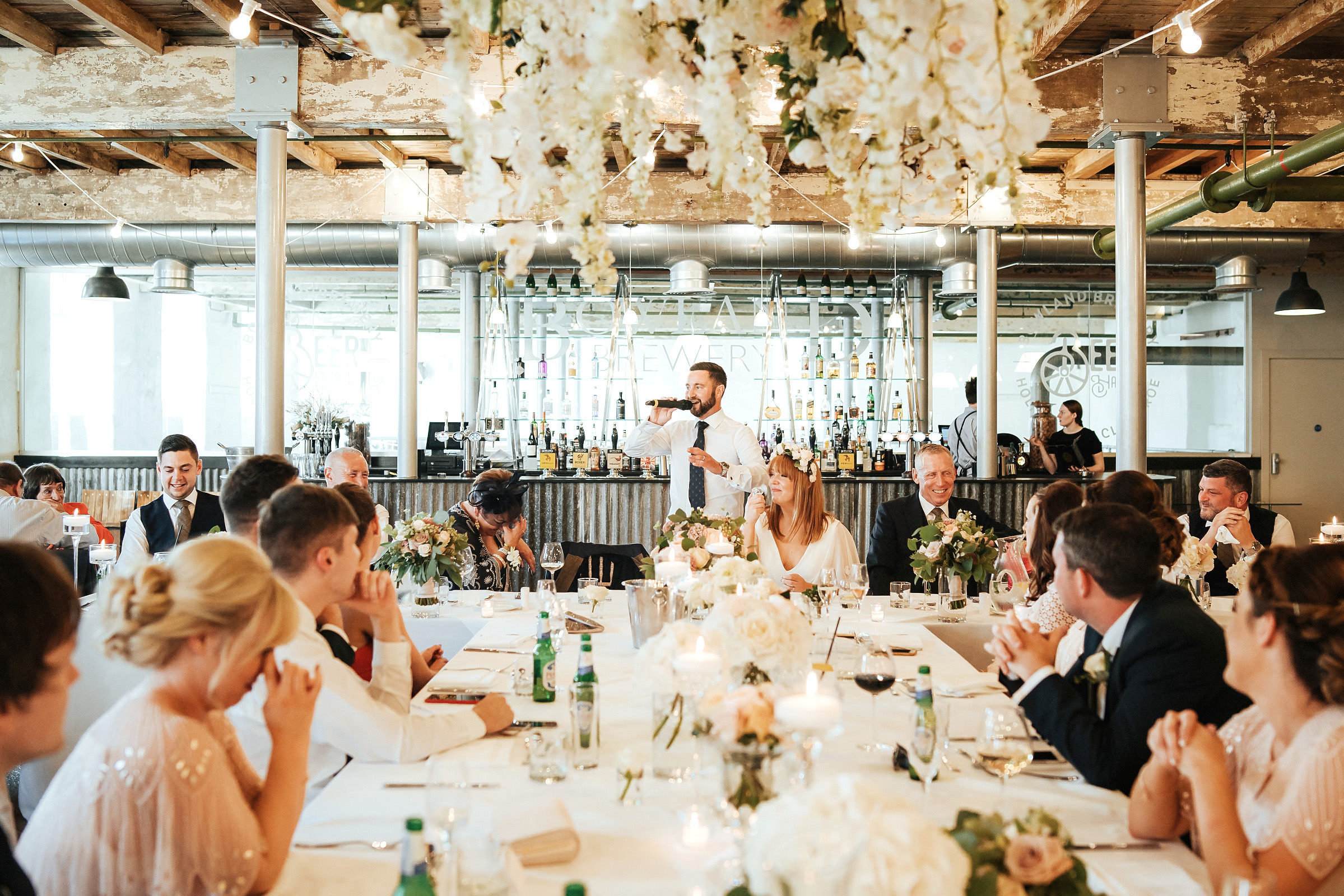 groom making a speech at Holmes Mill