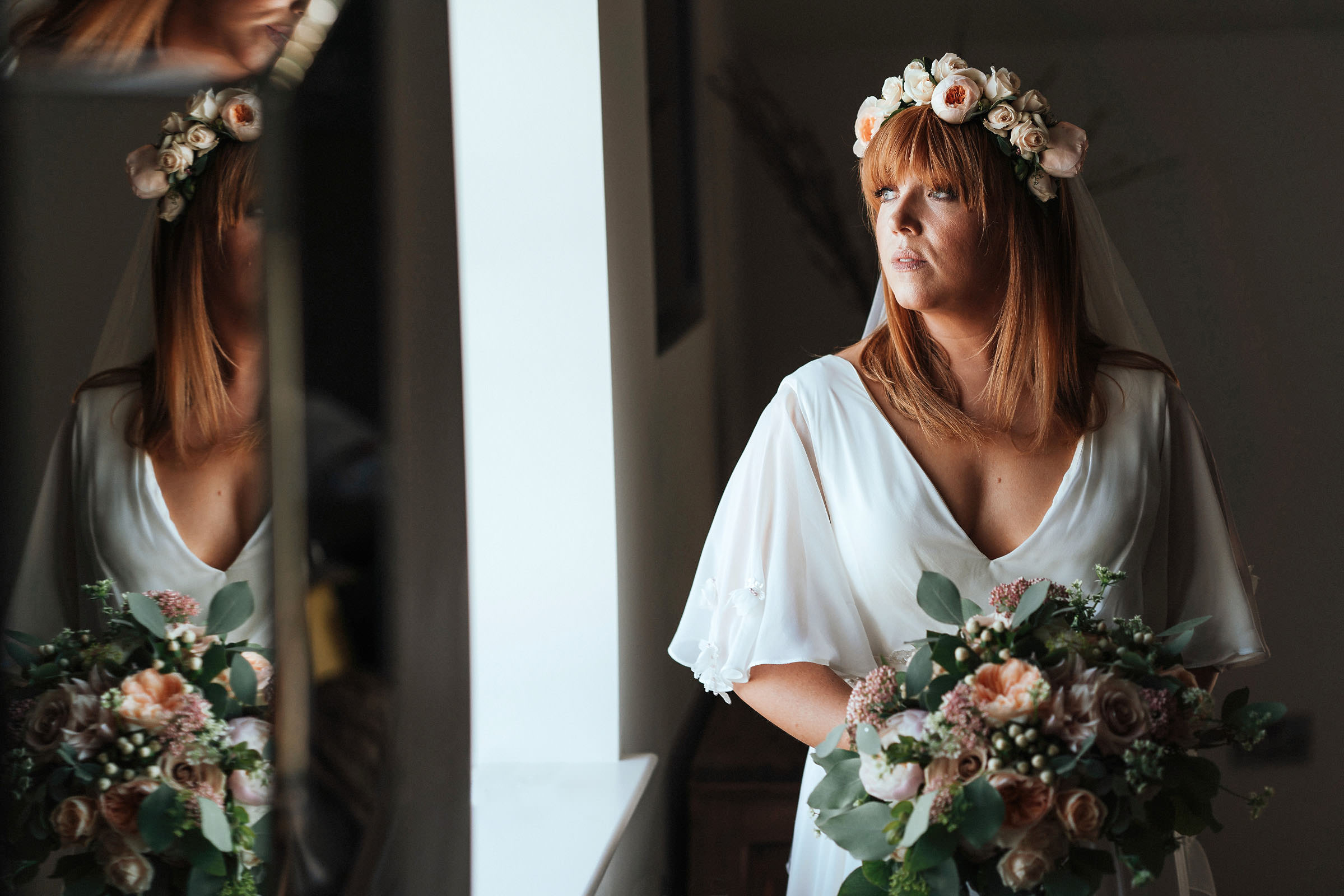 beautiful bride looking out of window