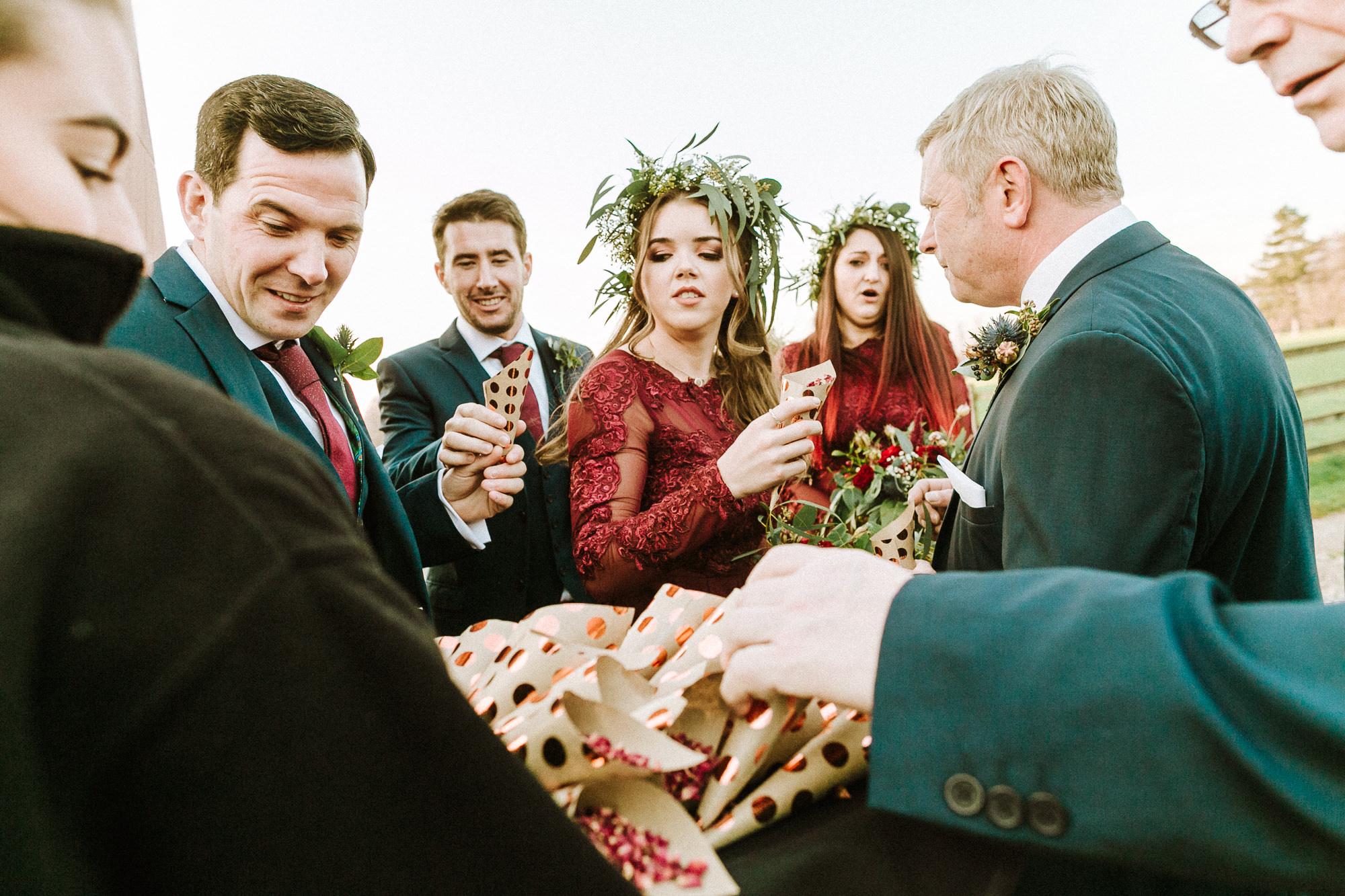 guests grabbing confetti