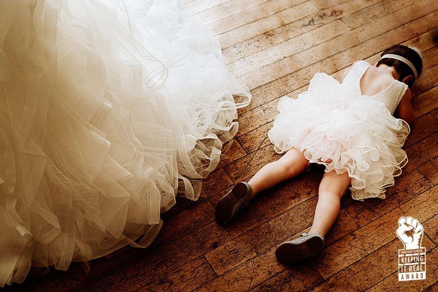 flower girl tantrum lying on floor