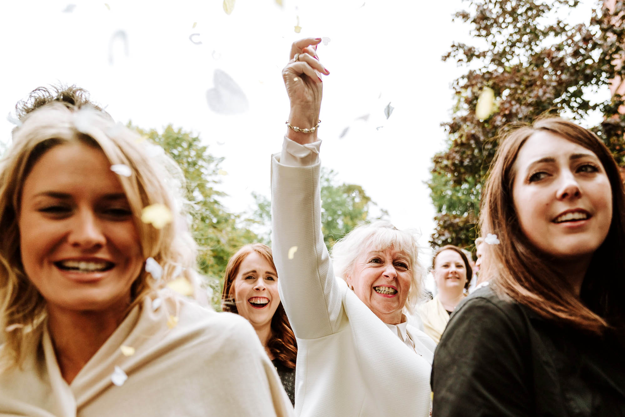 wedding guest tosses confetti