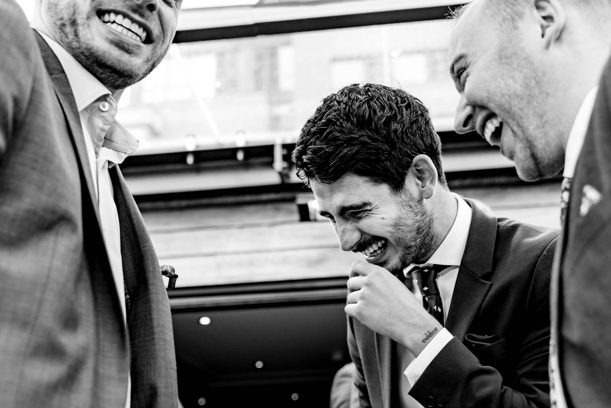 happy male wedding guests