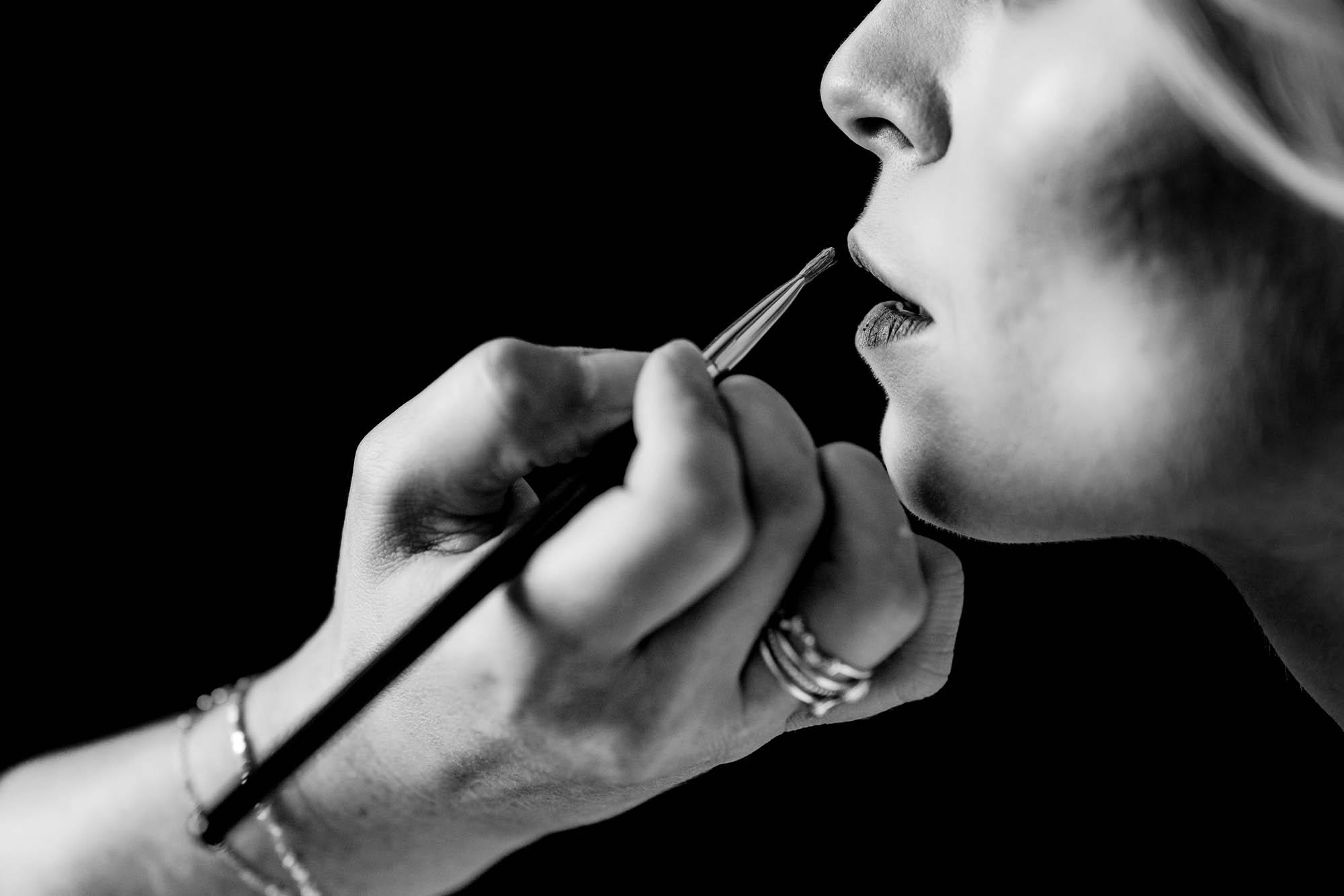 close up bride having makeup applied