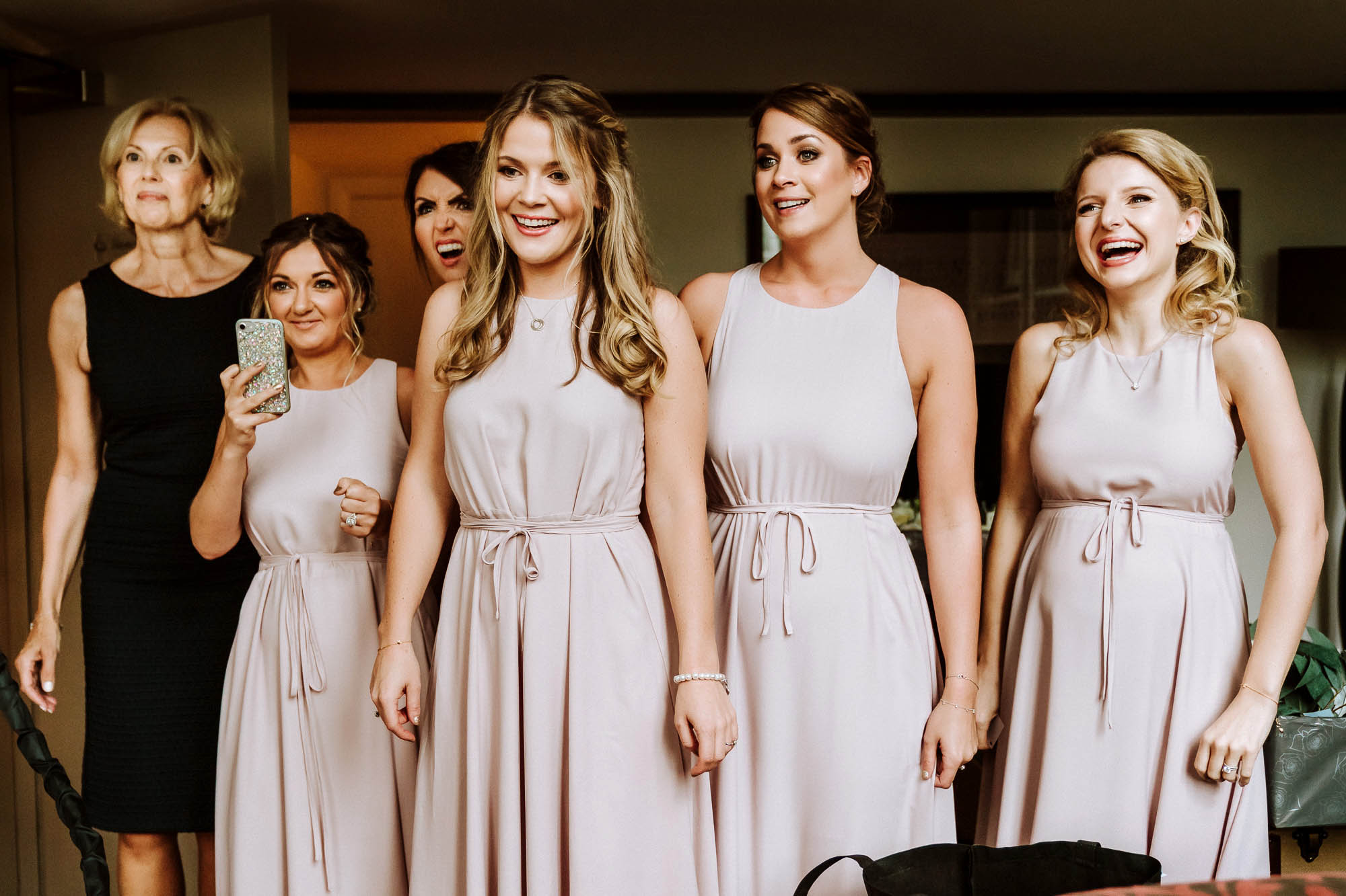 bridesmaids in dusky pink dresses smiling