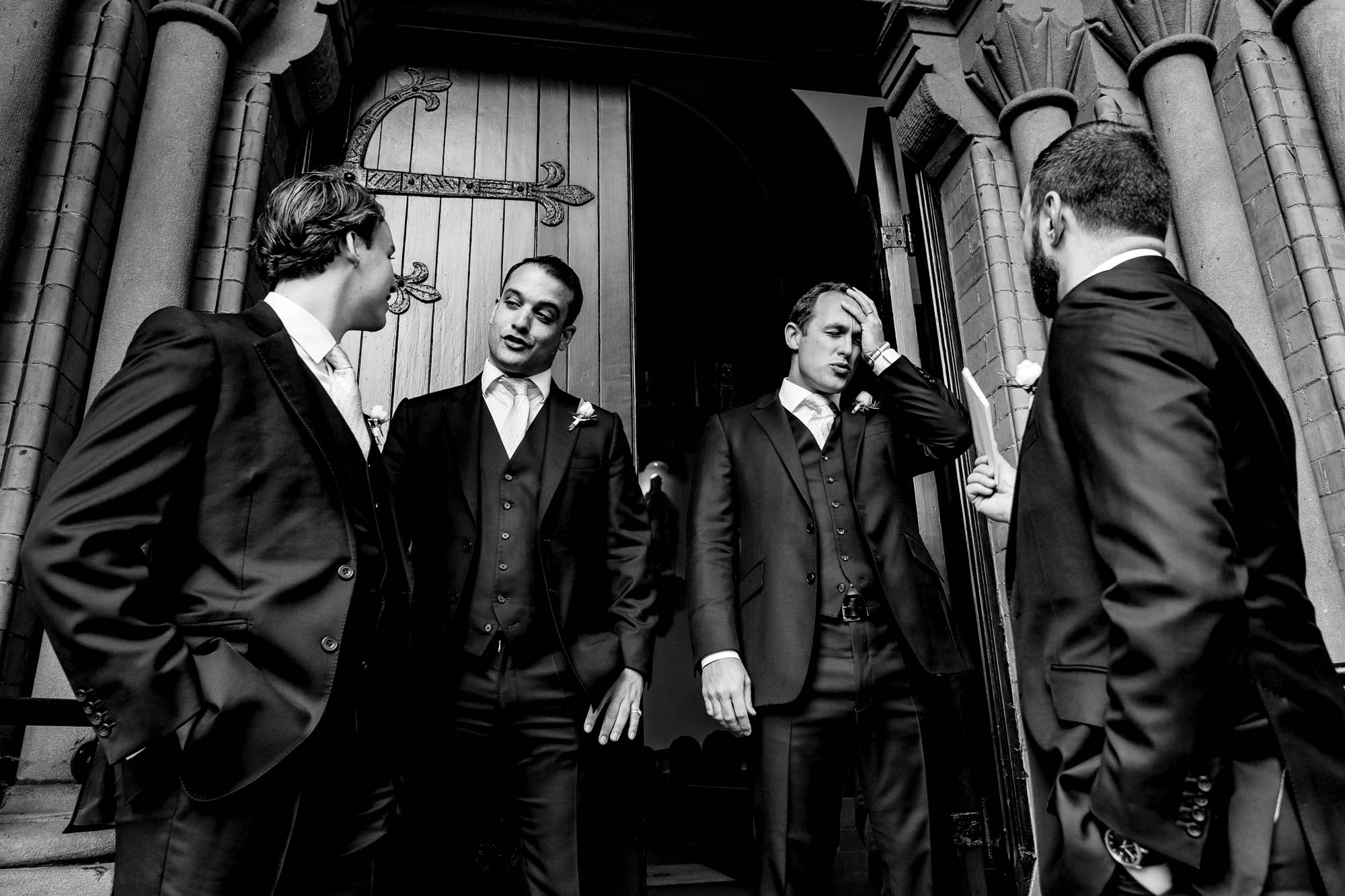 groomsmen outside church doors