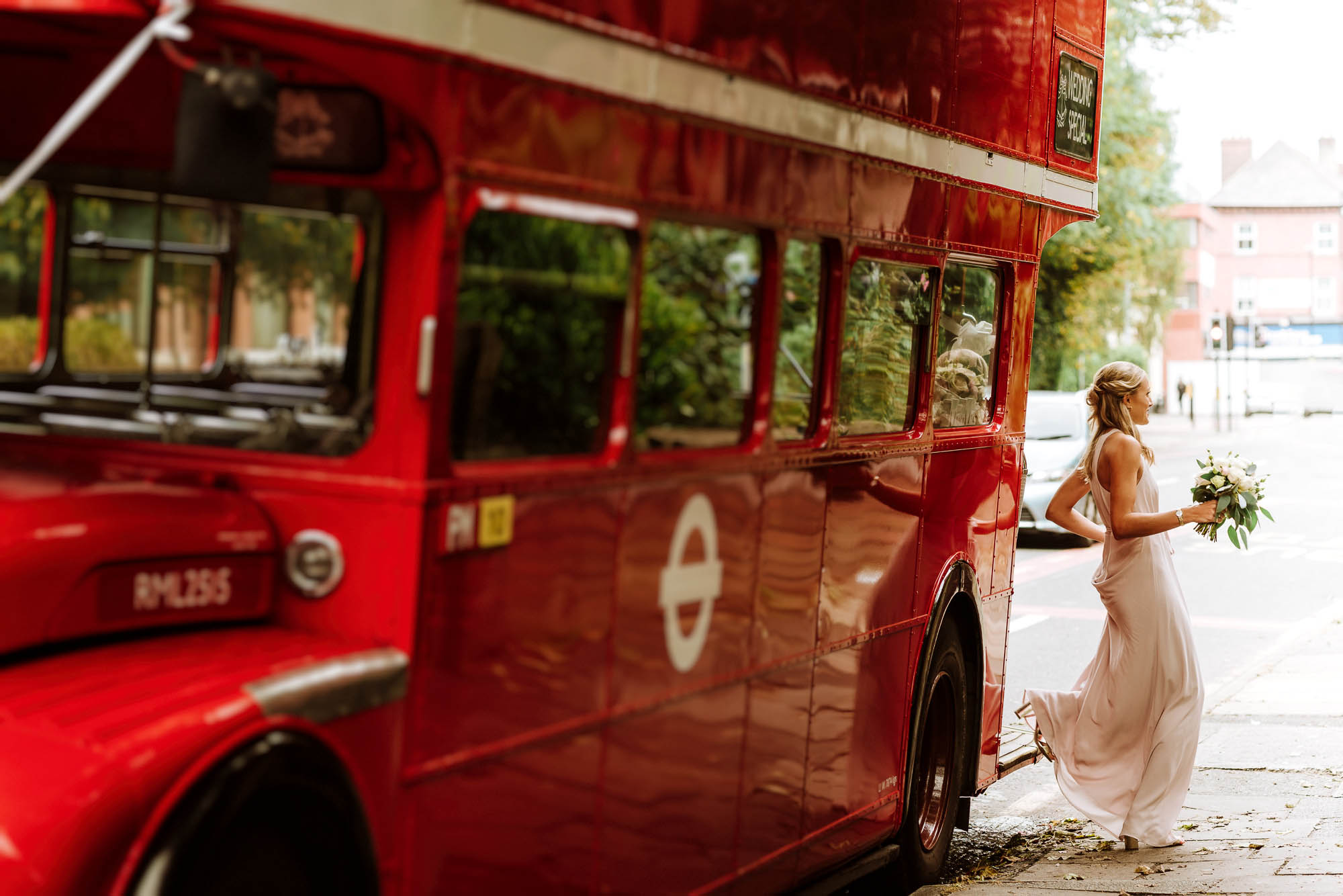 bridesmaid stepping off wedding bus