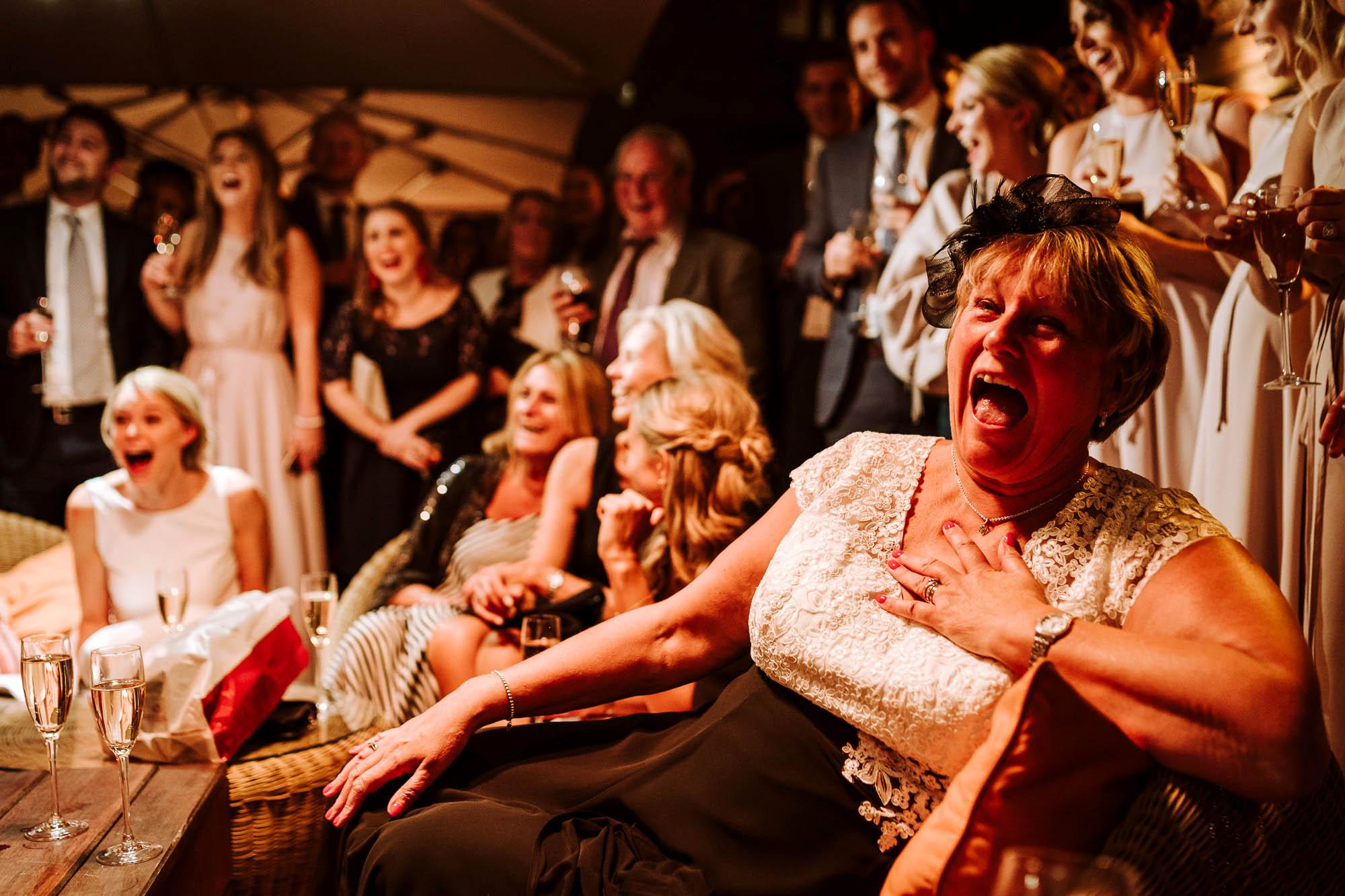 wedding guest laughing at speech