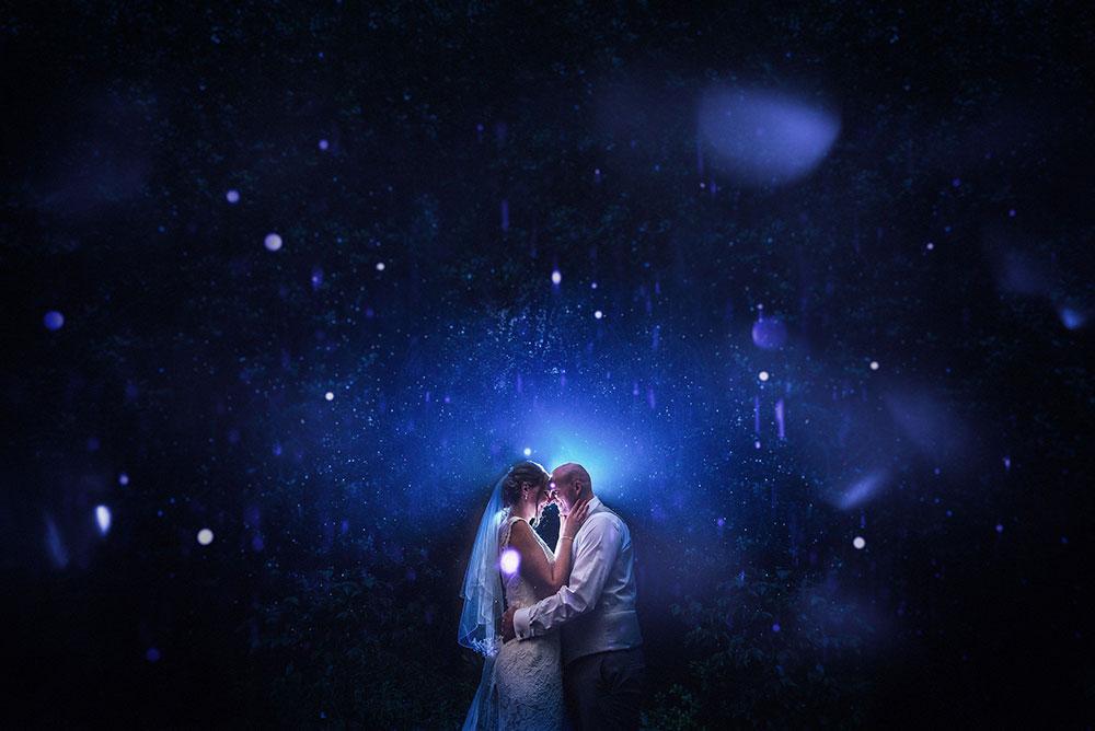 Bride and groom in rain