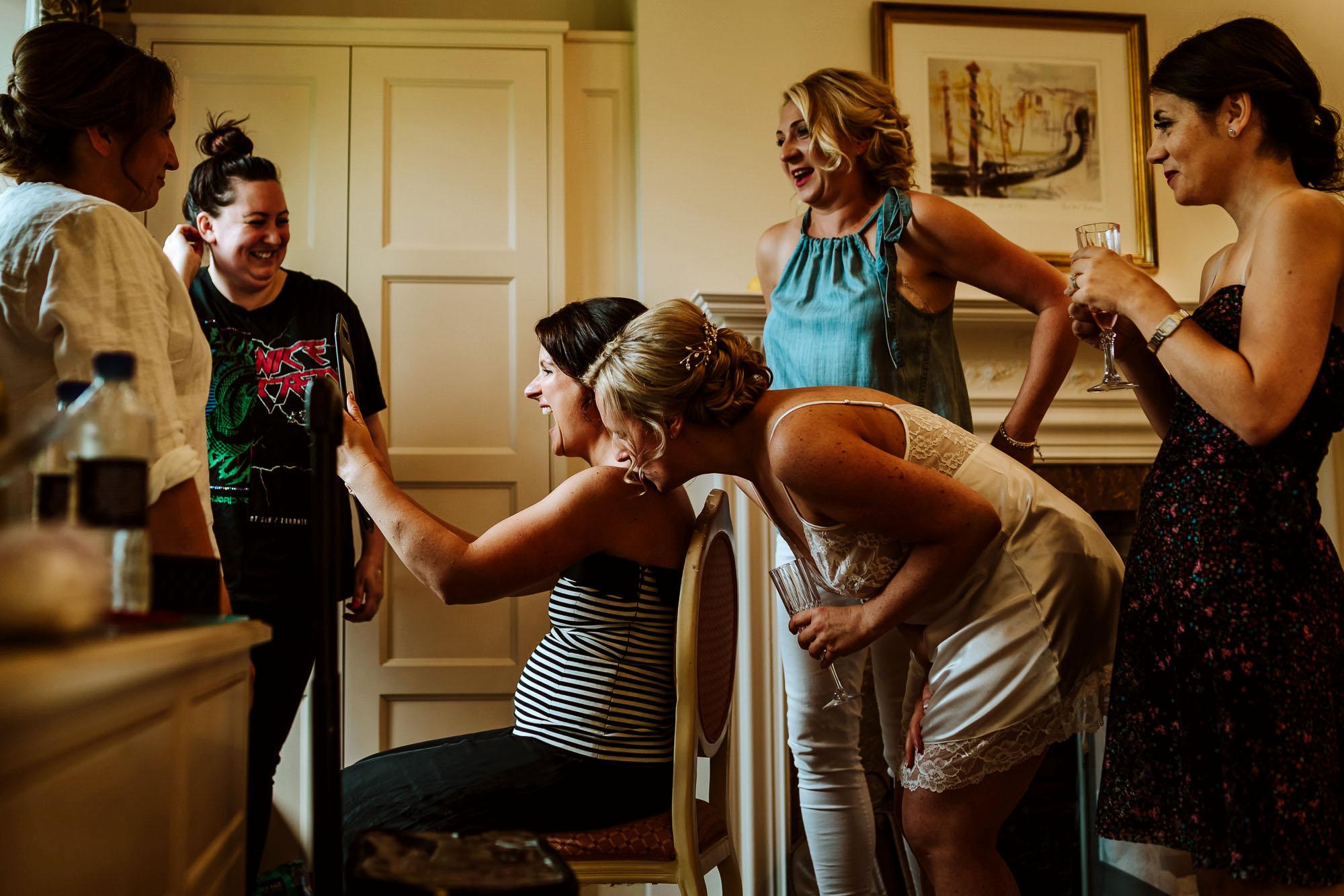 bridesmaids having makeup done