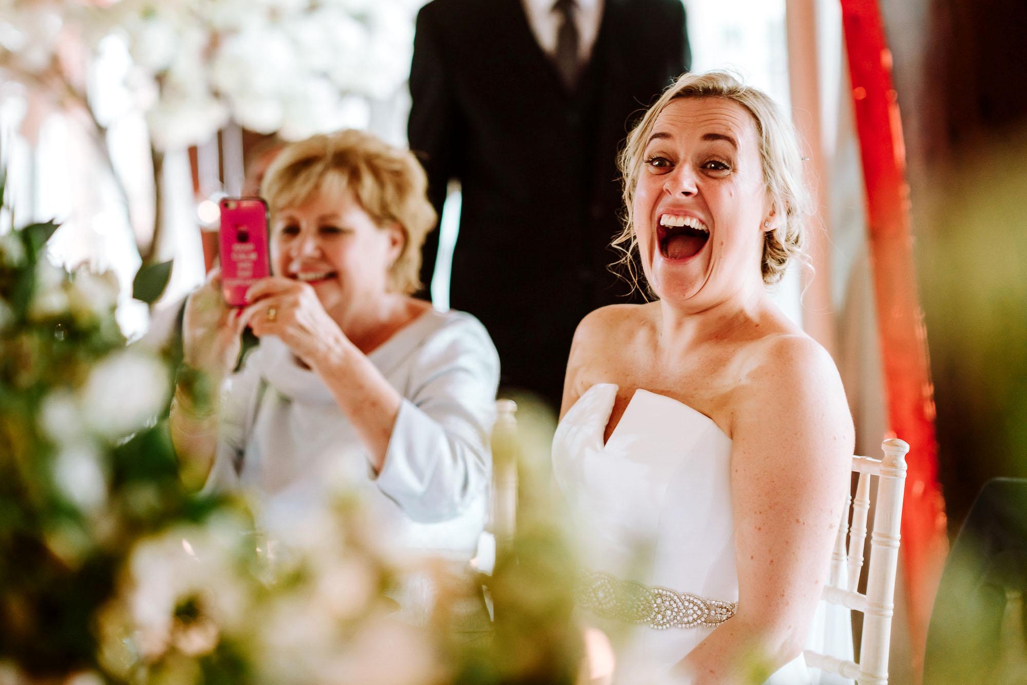 bride laughing during wedding breakfast