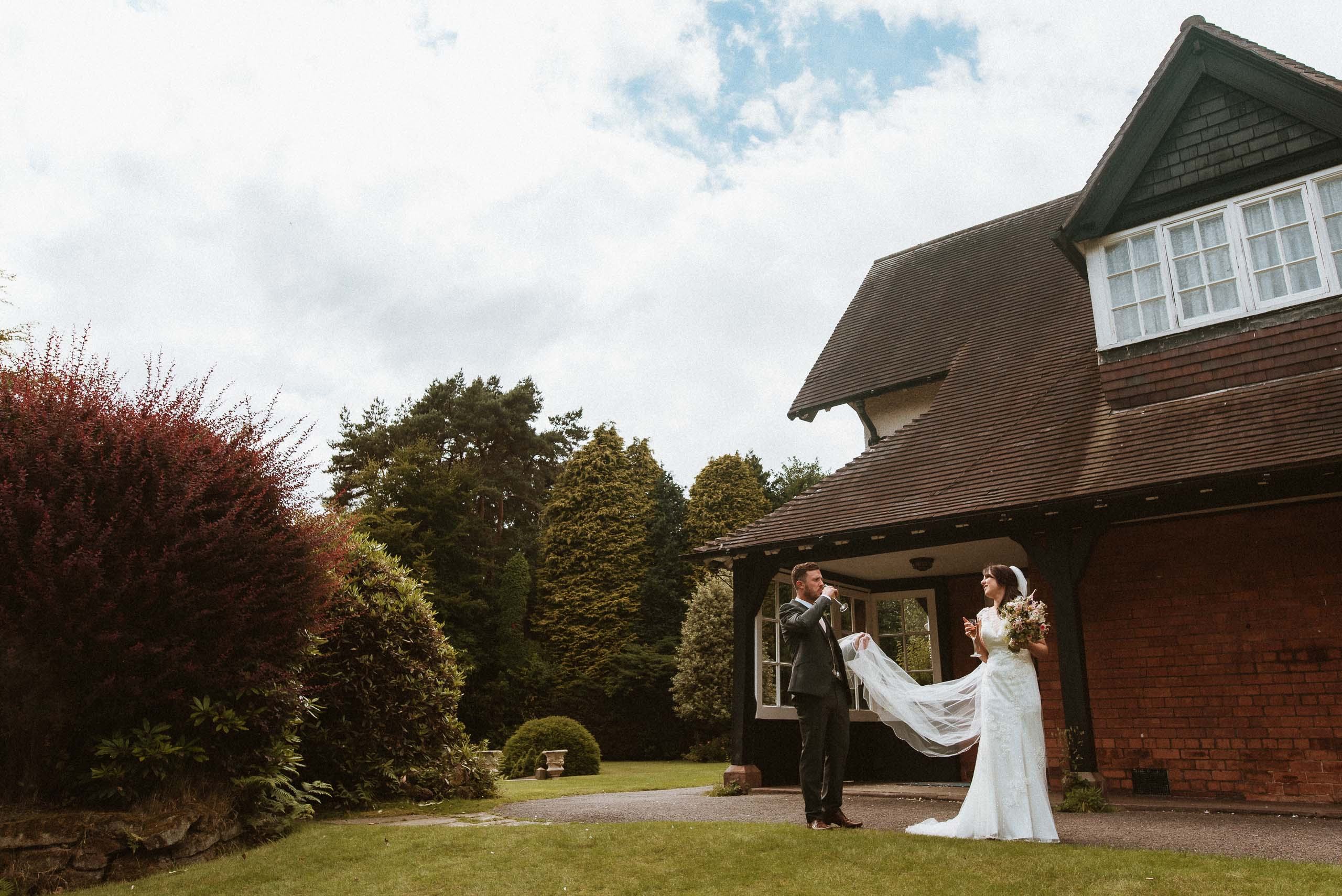 bride and groom standing outside Mere Court