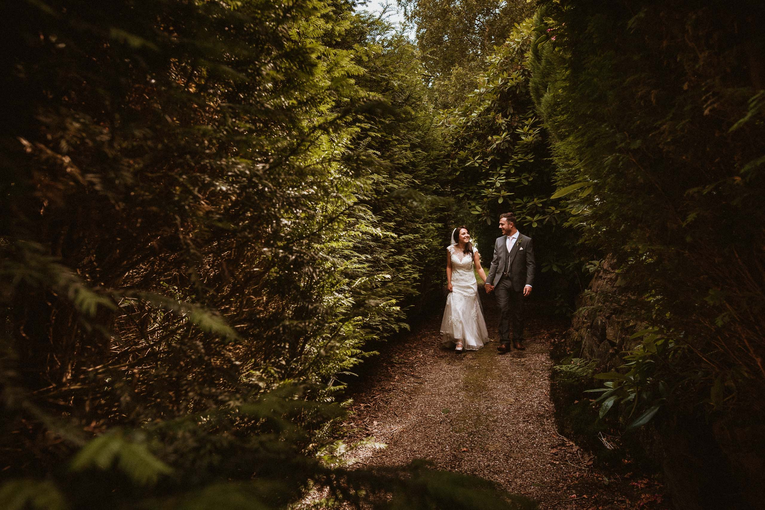 bride and groom walking outside mere court