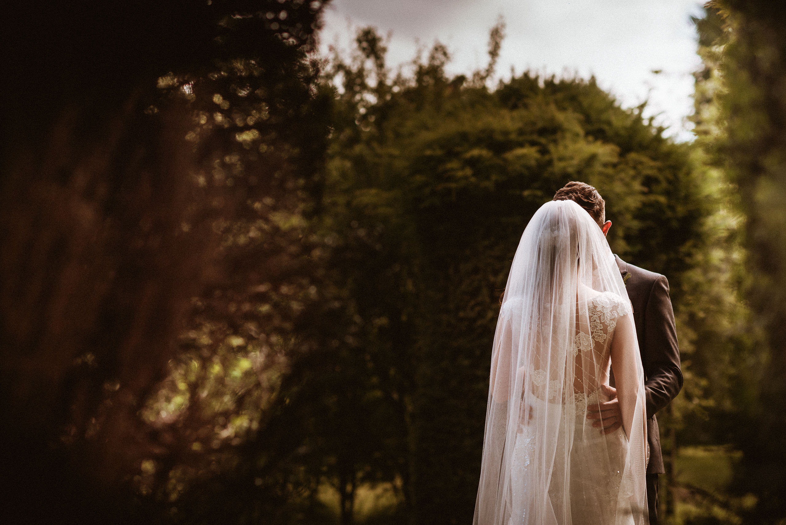portrait of the bride showing off a cathedral length veil