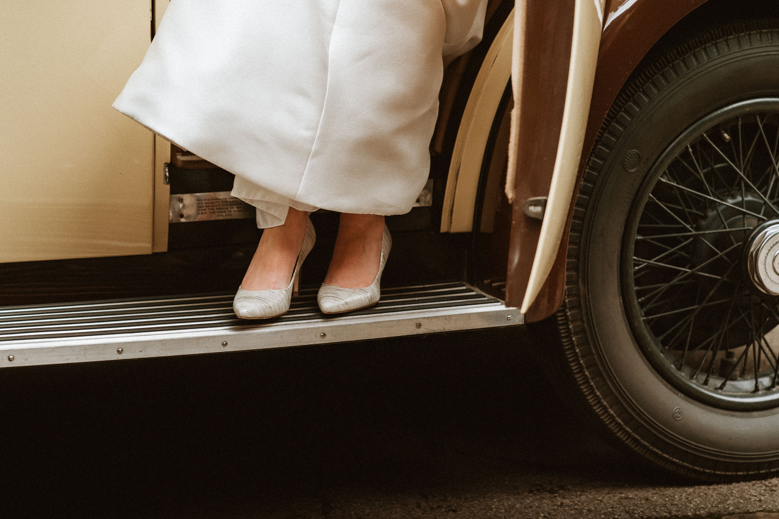 closeup of brides shoes as she gets out of wedding car