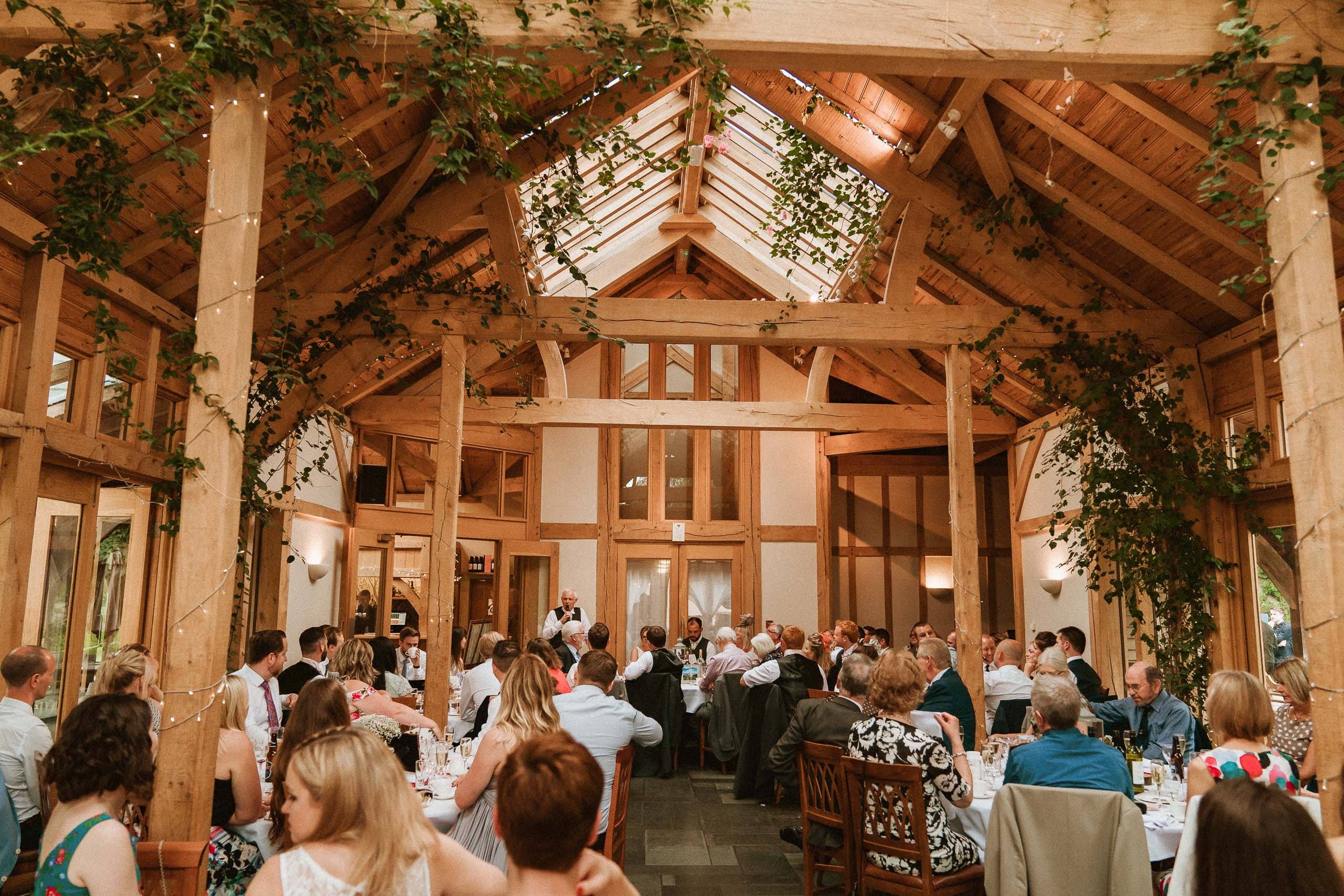 wide interior image of wedding barn