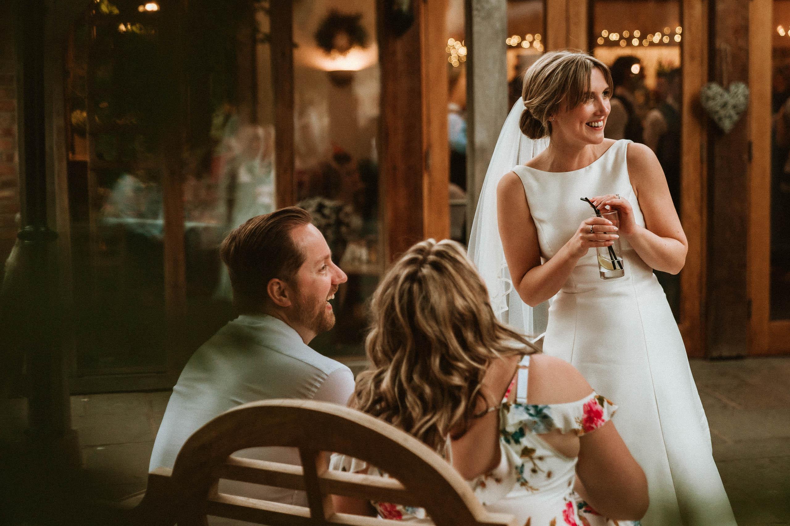 bride smiling outside oak Tree of Peover