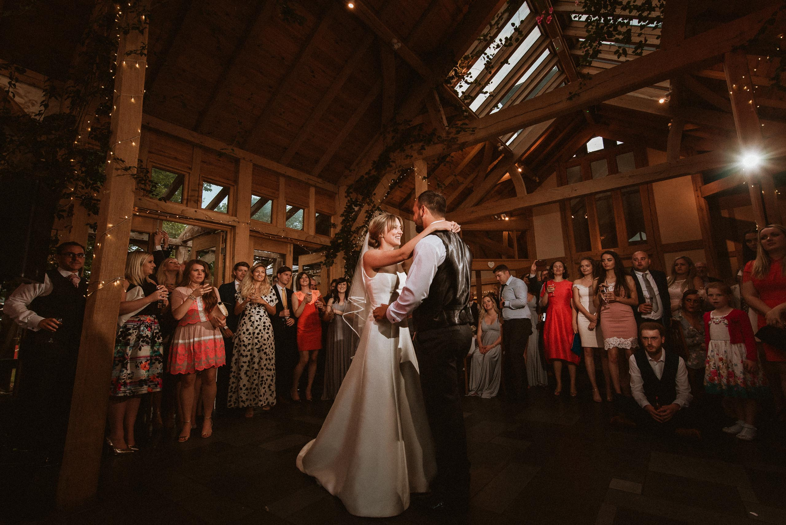 bride and groom performing their first dance inside barn at Oak Tree of Peover