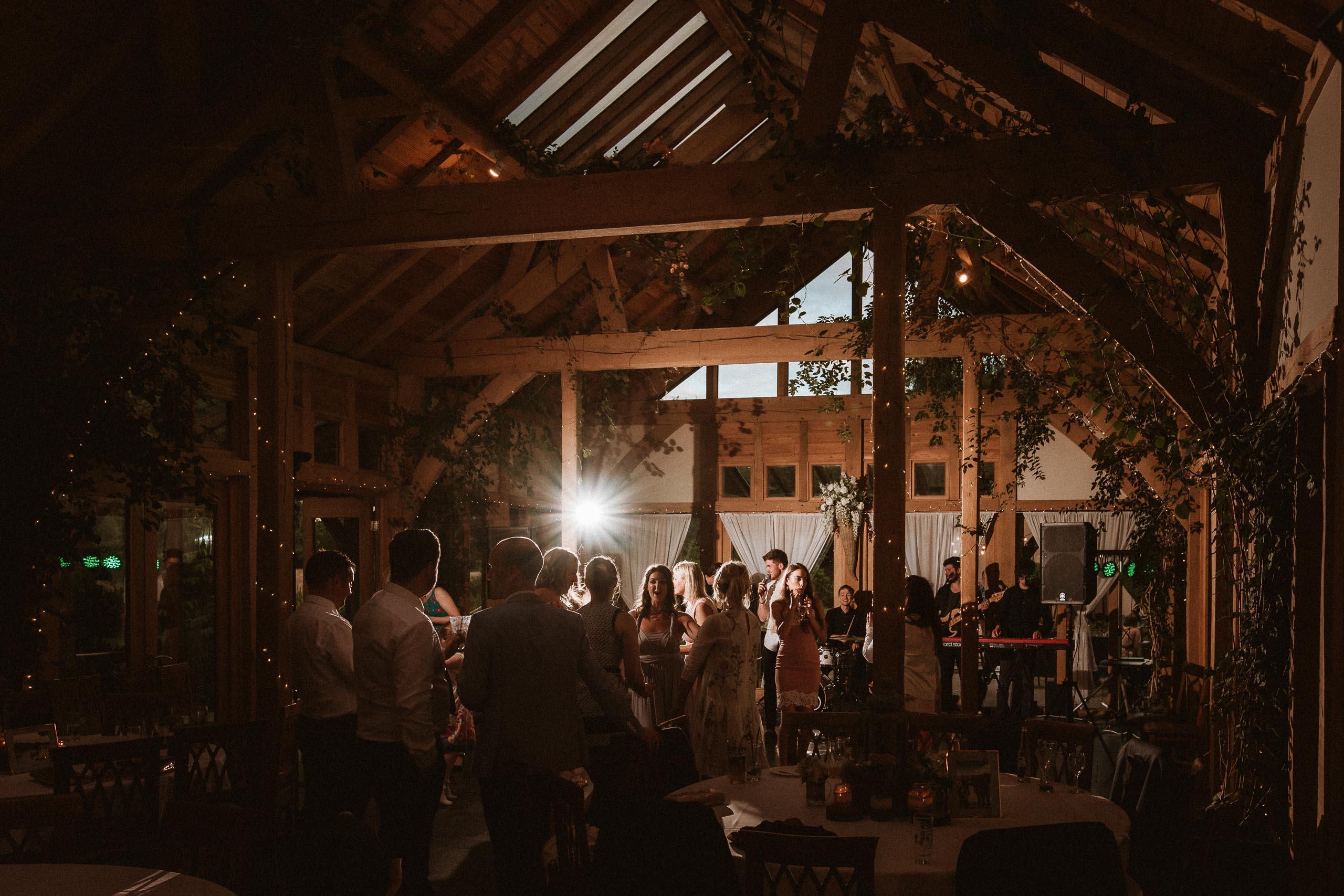 guests dancing inside barn at Oak Tree of Peover